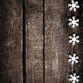 Christmas Rustic Background With White Snowflakes And Free Text Space. Festive Vintage Planked Wood