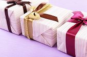 Cute presents on light blue uneven background