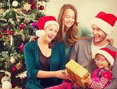 stock photo of christmas baby  - Christmas Family with Kids opening Christmas gifts - JPG