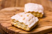 apple turnover . a close up shot on the wooden background