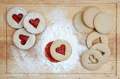 stock photo of linzer  - Linzer cookies incised into the shape of hearts - JPG