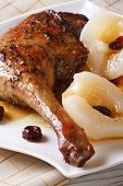 Roasted Duck Leg With Pears And Raisins Closeup Vertical