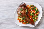 Roasted Duck Leg With Steamed Vegetables Horizontal Top View