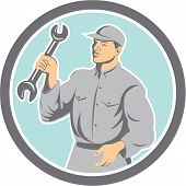 Mechanic Holding Spanner Wrench Circle Retro