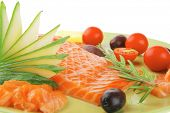smoked salmon fillet isolated on plate with rosemary