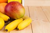 halved citrus fruit and mangos