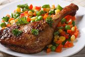 pic of roast duck  - delicious roasted duck leg with vegetables on white plate close - JPG