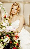 beauty young bride alone in luxury vintage interior with a lot of flowers