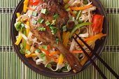 Roasted Duck Leg With Rice Noodles On A Bamboo Table. Top View