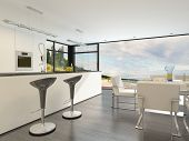 Modern open plan kitchen with a bar counter with stylish contemporary design bar stools, fitted cabinets and appliances and a large bright view window. 3D Rendering.