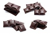 Dark Chocolate Bars Stack With Crumbs Isolated
