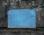 Old Blue Blank Weathered Noticeboard With Sun City Buildings Doodles