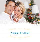 Composite image of couple embracing at christmas against border