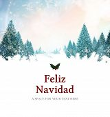 Feliz navidad against snowy landscape with fir trees
