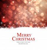 Merry christmas against light design shimmering on red