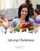 Woman showing Christmas turkey for family dinner against merry christmas