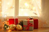 Beautiful Christmas gifts on windowsill