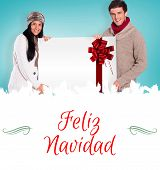 Composite image of young couple holding a poster against Christmas greeting card