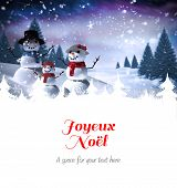 Joyeux noel against snowman family
