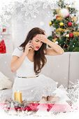 Concentrated brunette on the phone on christmas day against christmas theme frame in silver