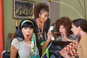 picture of obscene  - Group of four retro ladies listening to telephone - JPG