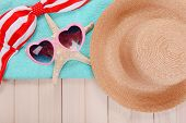 Summer items on wooden background