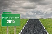 2015 in bold grey against road on grass