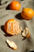 Juicy ripe tangerines on tablecloth