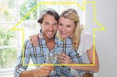 Cute smiling couple enjoying white wine together against house outline