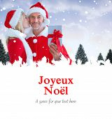 festive couple against joyeux noel