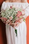 Wedding Bouquet In Bride's Hands Closeup
