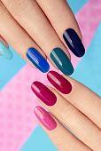 Blue pink nail Polish.