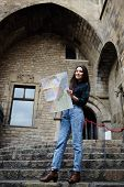 Young female traveler searching right direction on city map beautiful tourist woman on vacation