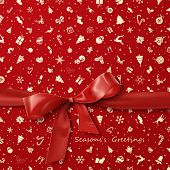 Red Bow over red Christmas wrapping paper icons pattern
