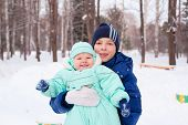 Happy Family Teenager And Baby Boy Kid In Winter Park