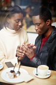 foto of san valentine  - Two people in cafe enjoying the time spending with each other portrait of young couple in love at coffee shop young couple at san valentines day handsome man declaration of love for his girlfriend - JPG