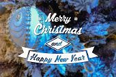 pic of blue spruce  - Merry Christmas and New Year greeting card on blurred festive decoration ball or toy and spruce blue colored background - JPG