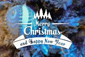 image of blue spruce  - Merry Christmas and New Year greeting card on blurred festive decoration ball or toy and spruce blue colored background - JPG