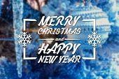 stock photo of blue spruce  - Merry Christmas and New Year greeting card on blurred festive decoration ball or toy and spruce blue colored background - JPG