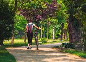 Cycling Outdoor - Biker Girl Exercise In The Park, Woman Fitness