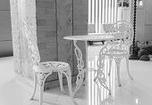White Table And Chair Sculpturing Tracery