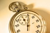 stock photo of stopwatch  - Single stopwatch isolated in closeup in sepia toning - JPG