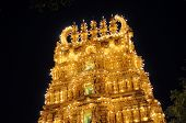 Illuminated Hindu temple in Mysore palace, India