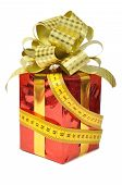 Red gift and measure tape over white