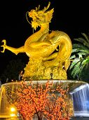 golden dragon statue at night