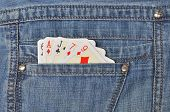 Close up playing cards plased in jeans pocket