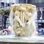 People Visit Famous Brockhaus Fountain In The Zeil In Frankfurt