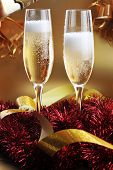Christmas Ribbons And Glasses With Champagne