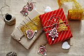 Christmas Gift Box And Decorations For Tree On Wooden Background
