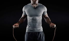 picture of jumping  - Muscular man skipping rope - JPG